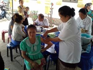 Woman receiving a flu shot.